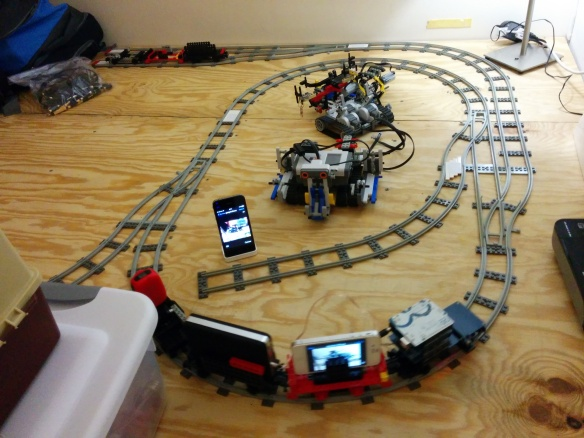 An Arduino/RFID/Wifi stack powers a model train through a test track.